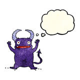 Cartoon little devil with thought bubble Stock Photo