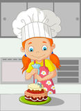 Cartoon little girl cooking cake Royalty Free Stock Photography