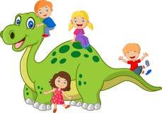 Cartoon little kid playing on the dinosaur Stock Photos