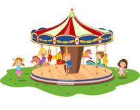 Cartoon little kid playing game carousel with colorful horses Stock Image