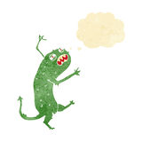 Cartoon little monster with thought bubble Stock Image