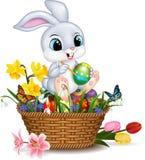 Cartoon little rabbit painting an Easter egg. Illustration of Cartoon little rabbit painting an Easter egg Royalty Free Stock Image