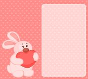 Cartoon little toy bunny with heart Royalty Free Stock Photos