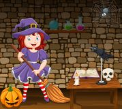 Cartoon little witch holding a broomstick Royalty Free Illustration
