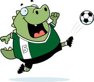 Cartoon Lizard Soccer Kick Royalty Free Stock Photo