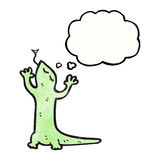 Cartoon lizard with thought bubble Stock Photography