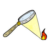 Cartoon magnifying glass starting fire Stock Photography