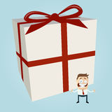 Cartoon man with big gift Royalty Free Stock Photography