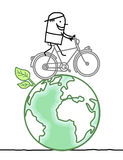 Cartoon man and bike on earth Stock Photos