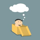 Cartoon man in a box with thought cloud Stock Photography