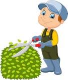 Cartoon the man cutting grass Stock Images