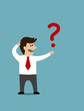 Cartoon man holding a question mark Royalty Free Stock Photos