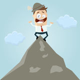 Cartoon man on mountain top Stock Image