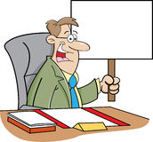 Cartoon man sitting at a desk and holding a sign Stock Photography