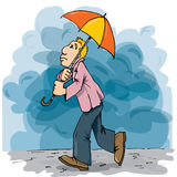 Cartoon of a man walking in the rain Stock Photos