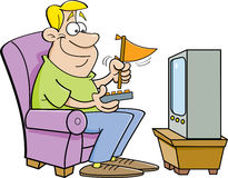 Cartoon man watching television and holding a pennant.  Stock Photos