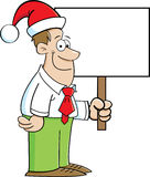 Cartoon man wearing a Santa Hat and holding a sign Stock Photos