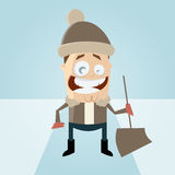 Cartoon man in winter with a snow shovel Royalty Free Stock Images