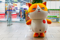Cartoon mascot cat in front of Bic Camera department store in Tokyo. TOKYO, JAPAN - NOVEMBER 28 2015: Unidentified Japanese dresses up a cute cartoon mascot cat royalty free stock image