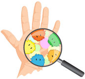 Cartoon microbes peek out from a magnifying lens. Hand with viru Stock Photo