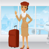 Cartoon Middle Eastern Flight Attendant. Waving in an airport with a suitcase Royalty Free Stock Photo