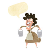 Cartoon milkmaid carrying buckets with speech bubble Royalty Free Stock Photos