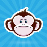 Cartoon Monkey Face with Sad Expression on Blue Background Royalty Free Stock Images