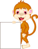 Cartoon monkey holding blank sign Royalty Free Stock Image