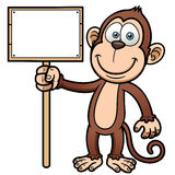 Cartoon monkey with wooden sign Royalty Free Stock Image