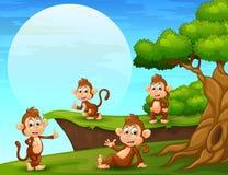 Cartoon monkeys playing near the cliff royalty free illustration