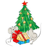 Cartoon mouse divide the cheese under the Christmas tree Stock Photo