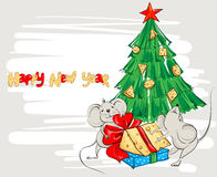 Cartoon mouse divide the cheese under the Christmas tree Royalty Free Stock Photography