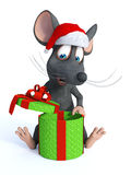 Cartoon mouse wearing Santa hat and opening Christmas gift. Royalty Free Stock Image
