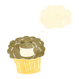 Cartoon muffin Stock Images