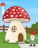 Cartoon Mushroom House. And a gnome in a country landscape. Eps file available Royalty Free Stock Photo