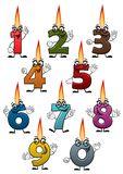 Cartoon numbers characters with birthday candles. Colorful cartoon numbers characters with birthday candles , cheerful smiles and bright flames isolated on white Stock Photos
