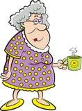 Cartoon old lady holding a coffee mug. Stock Image