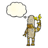 Cartoon old robot with thought bubble Stock Photo