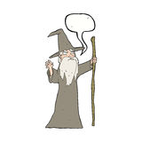 cartoon old wizard with speech bubble Stock Images