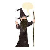 Cartoon old wizard with speech bubble Stock Photography
