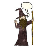 Cartoon old wizard with speech bubble Stock Image