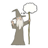 cartoon old wizard with thought bubble Stock Photos