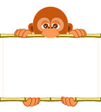 Cartoon orangutan cub holding a blank sheet of paper. Cute cartoon orangutan cub holding a blank sheet vector. All elements sorted and grouped in layers Stock Photography