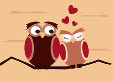 Cartoon owls on branch funny and romantic valentine's day illustration Royalty Free Stock Images
