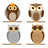 Cartoon owls set. Set of four cartoon owls for your design, isolated on white background.EPS file available Royalty Free Stock Photo
