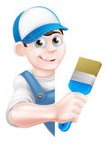 Cartoon Painter Decorator. A cartoon painter decorator in a cap hat and blue dungarees holding a paintbrush and peeking around a sign Royalty Free Stock Image
