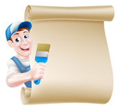 Cartoon Painter Decorator Scroll. A cartoon painter decorator in a cap hat and blue dungarees holding a paintbrush tool and peeking around a scroll Stock Images