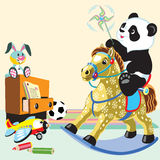Cartoon panda riding rocking horse Royalty Free Stock Image