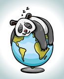 Cartoon panda sleeping on the globe. Royalty Free Stock Photography