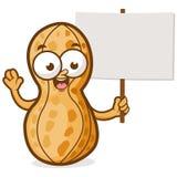 Cartoon peanut holding sign Royalty Free Stock Photography